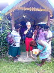 Debra is given a feet washing ceremony, her initiation by aboriginal women in Papua New Guinea