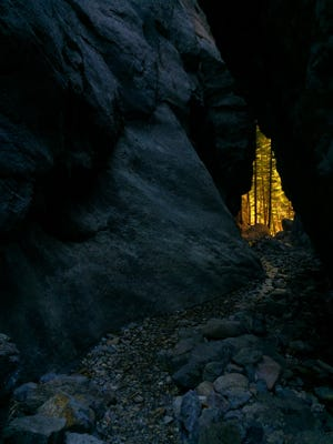 A golden sliver of light shines through Refrigerator Canyon in the Gates of the Mountains Wilderness east of Helena.