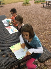 Weston Elementary's meditation garden offers a quiet place to read a book.
