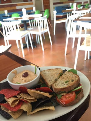 The tempeh pesto club, with a side of hummus and chips, at Melt in Northside