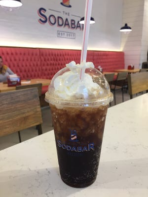 The Soda Bar offers craft sodas like root beer, cola, ginger ale, butterscotch root beer, lime, pomegranate lemonade, vanilla creme, orange cream and black cherry creme, along with diet versions of some. Of course, it's topped with house-made whipped cream.