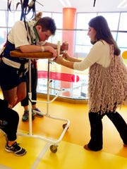 Mitchell Reidy with his sister Eleanor during his rehabiliation