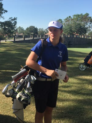 Jay High's Sarah Edwards walks toward clubhouse at Mission Inn and Resort, following her final round 76 that placed her tied for 24th and highest finisher among public school players in the Class 1A Girls State Golf Tournament near Orlando.