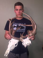 It took Andrew Roy, 18, about a week to clean and bleach the skulls of two bucks whose antlers were locked together in Table Rock Lake.
