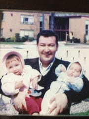 Irving Tobocman, pictured here as a young man with his two children, Susan and David.
