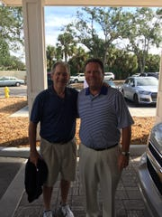 Former President George W. Bush, left, poses for a picture with Gene Fieger, the director of golf at The Club Pelican Bay in Naples, Fla., on Monday, Nov. 13, 2017.