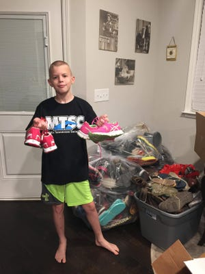 Justin Cline collected 120 bags of shoes to raise money to get a hearing dog.