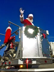 Santa arrived by firetruck at 1 p.m. Saturday, officially