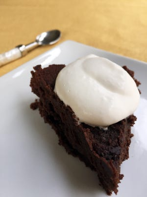 Don't feel guilty this holiday season about indulging in treats, like this rich flourless chocolate cake. By being mindful, you'll enjoy it more and eat less overall.