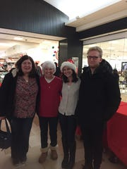 CONTACT volunteers Heidi Riley, Karen Patrick-Makolin, Bridget Makolin, Nicholas Semanchik at the 2016 holiday wrapping fundraiser.