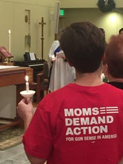 Colleen Mercier-Smith, a Hartland teacher and member of Moms Demand Action, at a candlelight vigil honoring victims of gun violence on Dec. 10, 2017 at St. Paul Episcopal Church in Brighton.