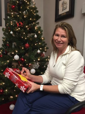 St. James School nurse Connie Lanter helps coordinate the St. James White Oak parish Giving Tree, changing the Christmas outlook for hundreds of needy families in the community,