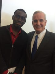 Emmanuel Oppong with Minnesota Gov. Mark Dayton. Dayton later appointed Oppong to serve on a state advisory board.