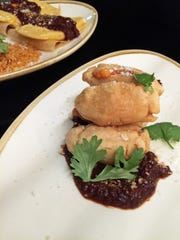 The molotes starter features potato and masa fritters,