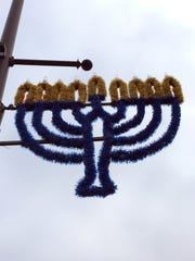 Menorahs as well as Christmas wreaths decorate the
