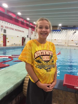 Brigitte Schroeder of Port Clinton won the diving competition at the Middle School Championshipat Oak Harbor.