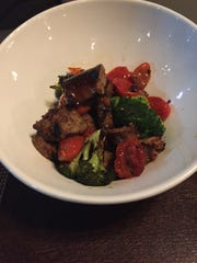Grilled garlic sausage with broccoli and tomato au