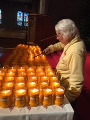 Sister Rose Stietz lights candles for Milwaukee's 2017