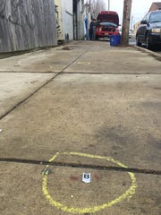 A Wilmington police evidence marker on Conrad Street marks where police believe Kevin Dyton went after killing his girlfriend, Annette Henry, in 2018.