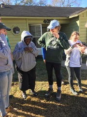 """Three students from the Newman House with a resident of Beaumont, Texas: from left, Kate Hogan, """"Miss Lilly,"""" Beth Ann Meluni and Sarah Sutton."""