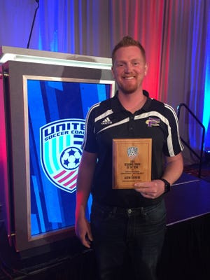 Fort Collins High School's Justin Stephens was named the high school boys Far West Region Coach of the Year.