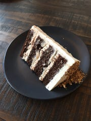 A slice of cookie dough cake at Scratch Bakeshop.