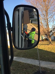Lafayette truck driver Dallas Griswold steadies a cardboard box on his pickup route Friday morning.