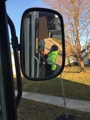Lafayette truck driver Dallas Griswold steadies a cardboard