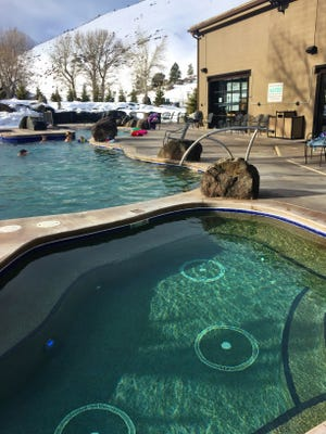 At Broadwater Hot Springs, a hot tub is next to a cooler pool, with a cold plunge pool to the side.