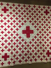 This quilt, a fundraiser for the Red Cross in Cascade