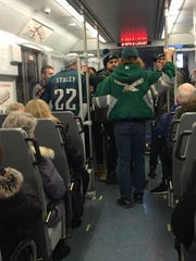 Eagles fans on the PATCO Hi-Speedline headed from South Jersey into Philadelphia fon Super Bowl afternoon to watch the game at taverns or hosue parties
