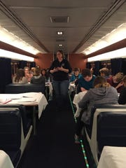 Alicia LaMagdeleine, assistant head of University High School of Carmel, leads a class on an Amtrak train. The class went on a nine-day trip across the country by train in January.