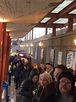 Fans line up on a rainy Wednesday afternoon outside PATCO'S Ferry Avenue station in Camden to buy ride tickets to Philadelphia for Thursday's  parade for the Philadelphia Eagles.