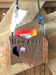 The Hogback Dreamer Journal hangs inside Hogback Covered Bridge in rural Winterset. Visitors leave messages as varied as they are, but many celebrate romance or mourn lost love.