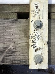 Recent romantic graffiti is visible on some of the