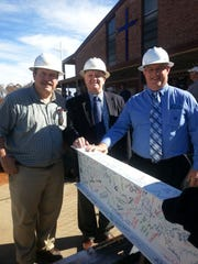 Bill Skelton, Sam Cely and Steve Henderson during construction of Our Lady of the Rosary Catholic Church.