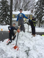 From left, John Loudon, Nicholas Danieli and Josh Loudon make $56 on March 7, 2018, shoveling snow for neighbors on Verona's Morningside Road.