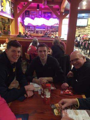 Michigan sophomore Jon Teske has dinner with his cousin, Drew Zuidema, and grandfather, Jim Zuidema.