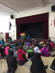 Students at J.J. Flynn elementary school met in the auditorium before going outside to observe National Student Walkout  day in Vermont, on March 14, 2018.