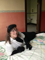 """Fifi"" reclines at  a former crib at 317 Central Ave."