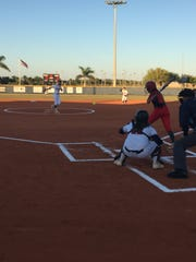 Estero starting pitcher Lauren Hobbs delivers to North