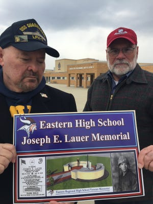 "Eastern Regional High School alumni John Masso, left, and Jack Gangluff are raising money to erect an outdoor memorial at the Voorhees school to former classmate and Vietnam War casualty Joseph E.. ""Jay"" Lauer of Gibbsboro."
