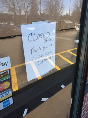 A sign hangs in the Quiznos in Poughkeepsie on Saturday.