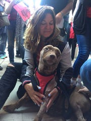 Fran Rizzo celebrates with her foster dog, Legend,