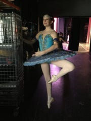 St. Lucie Ballet's Larenne Taylor warms up backstage at the Shakes the Ground competition in Orlando.