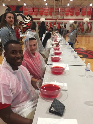 Vineland High School Class of 2018 President Jose Mateo heads the table of Jell-O-eating contestants on Wednesday.