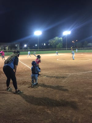 Two players from the 8- to 10-year-old minor league softball teams square off at Virgin Valley Little League Opening Day on April 2, 2018.