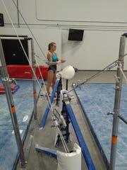 Gymnast Keerston Underkoffler prepares to perform an