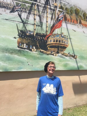 Carla Robinson, a Pensacola sailing icon, is a former crew member of the Elissa. Robinson crewed on Elissa's maiden voyage in 1989 from Galveston to Pensacola. She is posed in front of a maritime mural off Main Street in downtown Pensacola.