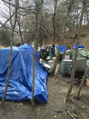 A settlement of homeless people on Spectrum's property